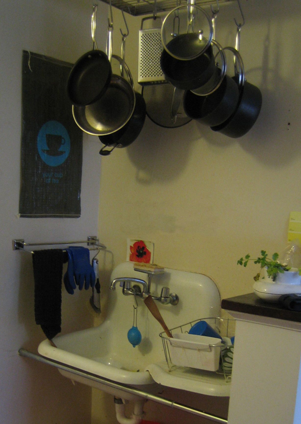 "Sink with ""My Cup of Tea"" hanging"
