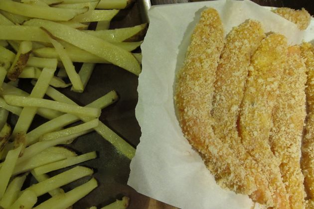 par-cooked french fries and breaded salmon filets await frying