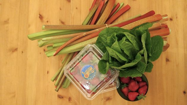 rhubarb, strawberries, and lettuce on a table