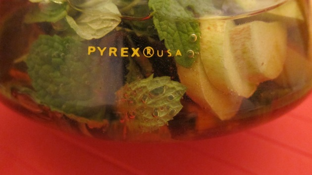 a closeup of a pyrex container filled with Minnesota Sangria