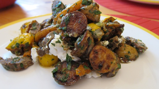potato carrot and summer squash medley on a white plate at the dinner table