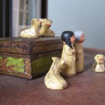 clay figure of Joseph, Mary, and the livestock awaiting baby Jesus