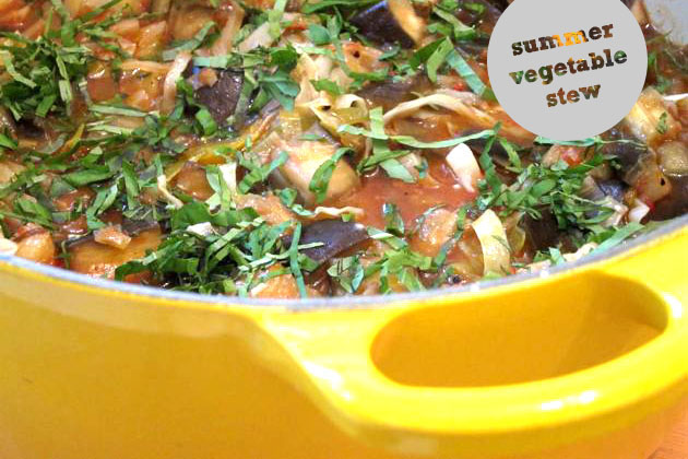 summer vegetable stew in a yellow pot