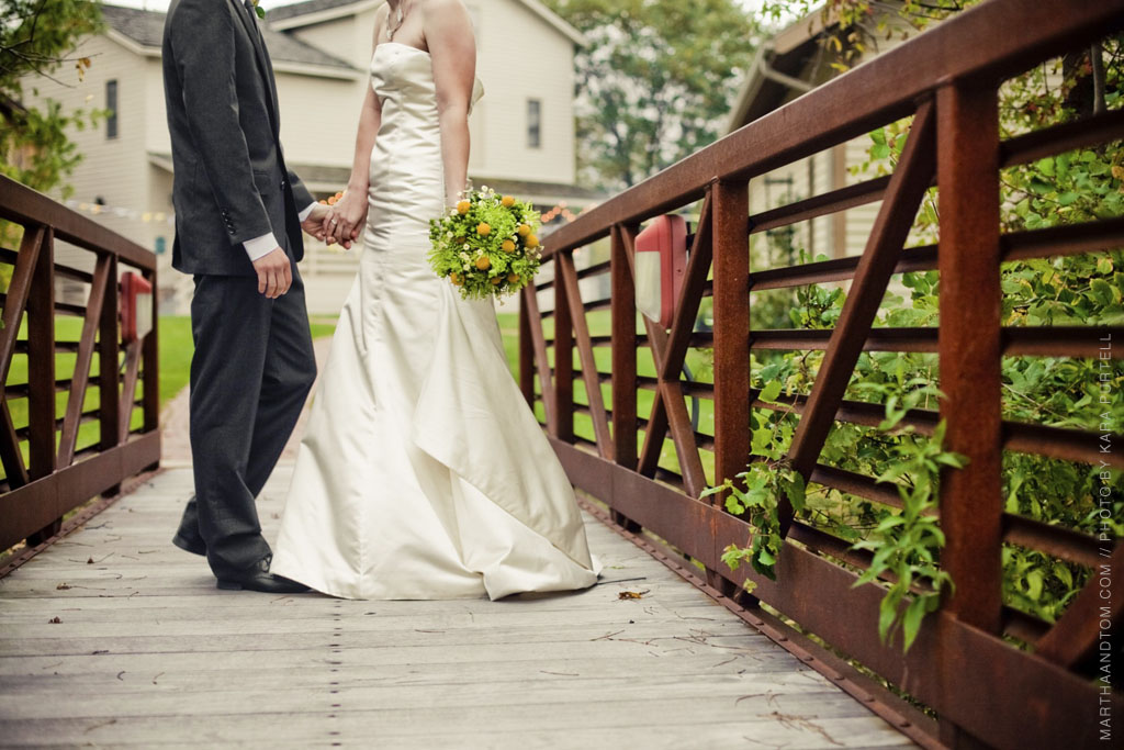 a photo of the bride and groom on a bridge