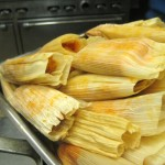 The finished pork tamales. The masa has turned red from being mixed with salsa roja.
