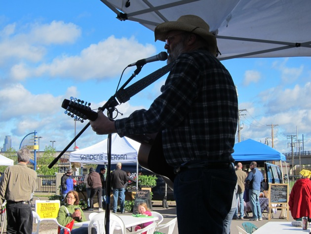 Steve West welcomes visitors with music