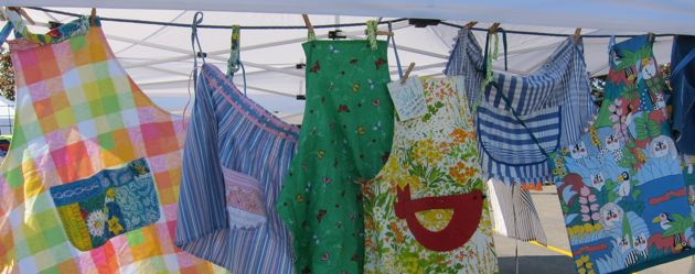 colorful aprons hanging in the sunshine