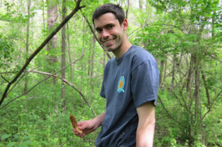 Tom holds a morel in hand
