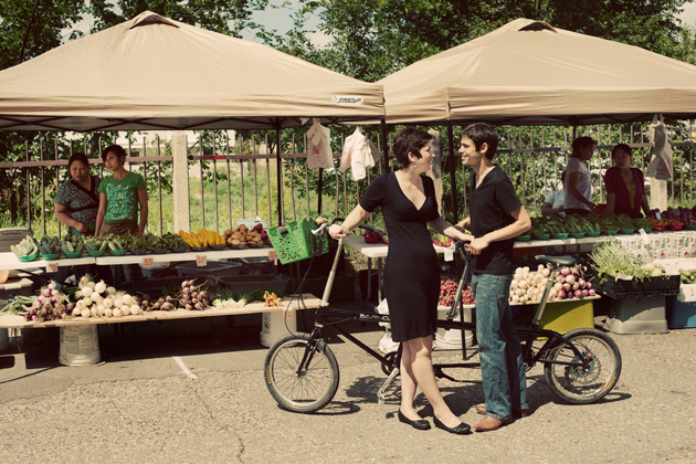 Martha and Tom with a Tandem Bike at the Uptown Market