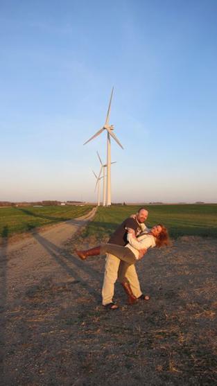 a couple on a windfarm