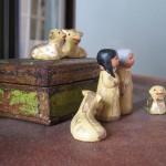 clay figure of Joseph, Mary, and the livestock awaiting baby Jesus