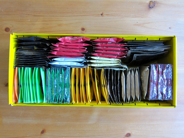 a yellow box full of tea bags in paper packages