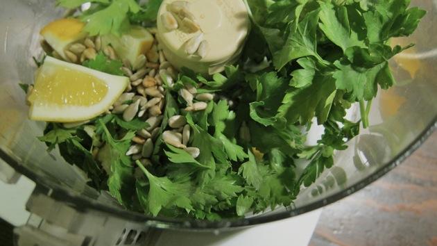 blending pesto ingredients in a food processor