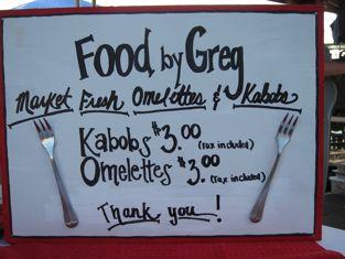 a sign for a market food vendor