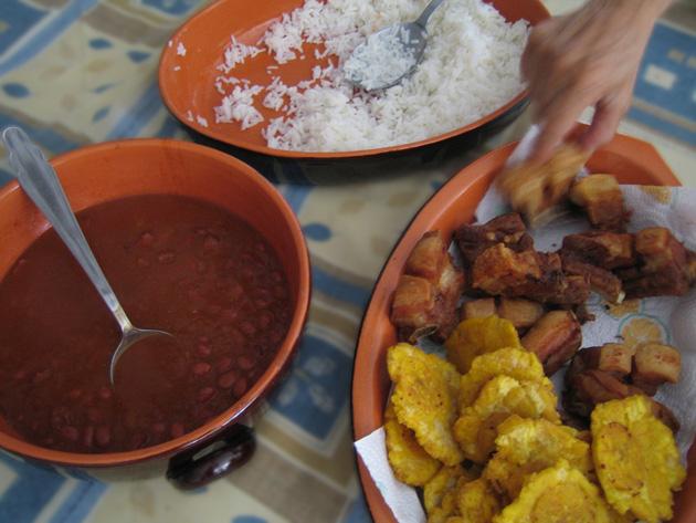 chicharrón, beans, rice on a table top