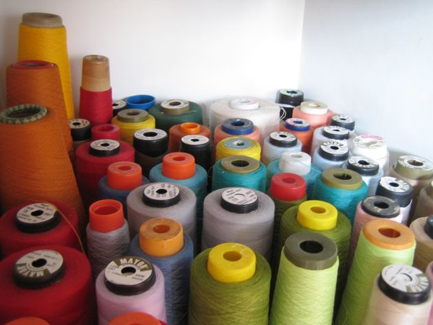 many colored spools of thread